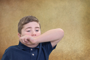 Boy Covering Sneeze with his Arm