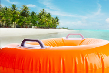 Inflatable orange cushion on the beach