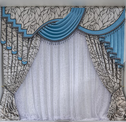 Turquoise curtains with lambrequins