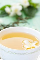 Green tea and jasmine.