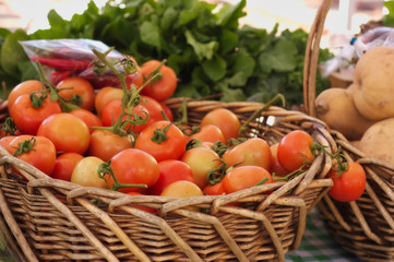 basket of fresh tomatoes at the local market