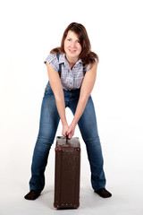 Beautiful young woman with a suitcase