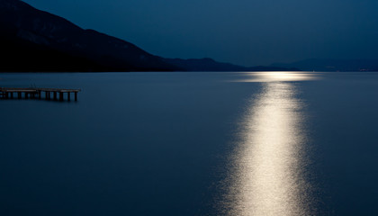 Blue moon reflected on the ocean