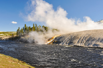 Hot water flows into Firehole River, Yellowstone National Park