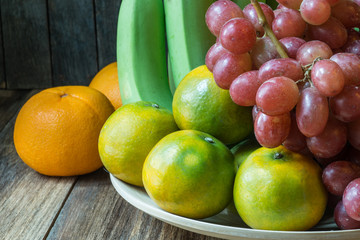 close up shot of several kind of fruits on wooden table.