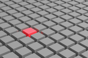 One red cube amongst a mass of grey cubes