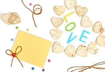 Valentines day. Word Love and Hearts made of bark