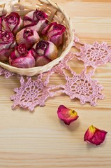 lovely dried roses on the table with light wood