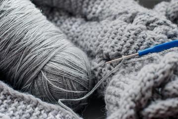 gray yarn and hook