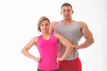 Sports man and woman posing on a white background