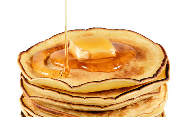 Pancakes with butter and syrup.