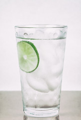 Water in glass with lime and condensation
