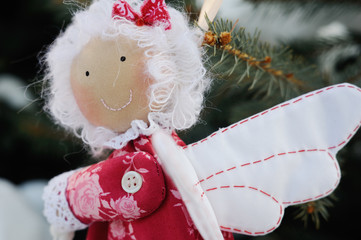 Christmas tree toy angel with heart in hands. Christmas Toy ange