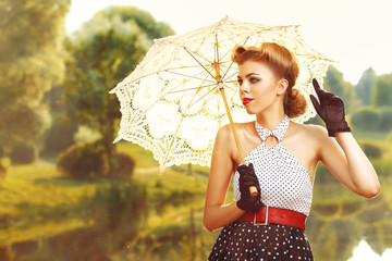 beautiful retro woman in vintage clothes with umbrella under the