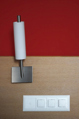 Sconce / Wall Lamp and electric switches against dual background