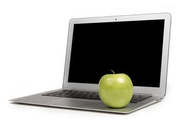 Focus on Green Apple on a Laptop