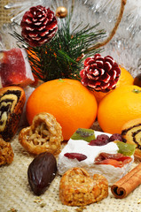 Christmas decoration with tangerines, turkish delight; lokum.