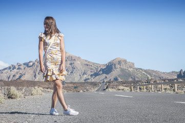 Girl on a deserted road