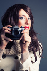 pretty young woman with camera