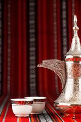 Ornate arabian tea cups and a dallah tea pot