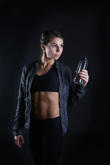 Sporty woman holding drinking bottle