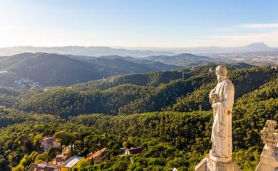 Sculpture Apostle and mountains near Barcelona