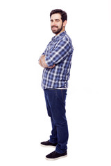 Full body portrait of young casual man smiling, isolated on whit