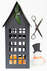 Tall Black Paper House with Leaves, Candles and a Snowman