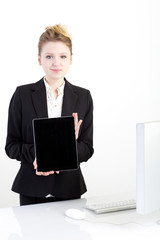 young businesswoman showing blank digital tablet