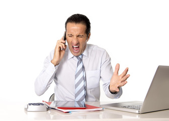 angry senior businessman in stress talking on mobile phone