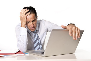 senior businessman in crisis working on computer in stress