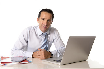 senior businessman working on computer confident and relaxed