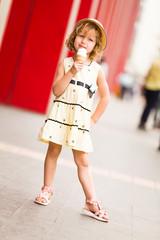 Smiling girl holding her ice cream