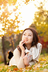 Young woman in the rays of the autumn sun