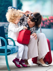 Mom and daughter with red bags