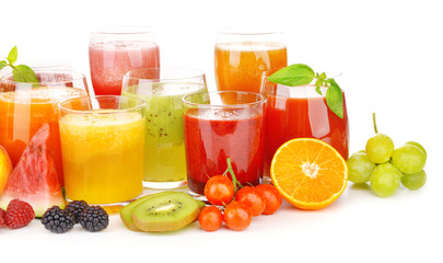Glasses of tasty fresh juice, isolated on white