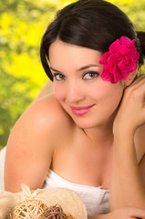 closeup of beautiful young girl with flower on her head in