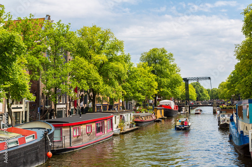 canvas print picture Amsterdam canals and  boats, Holland, Netherlands.