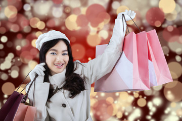 Girl in winter coat with shopping bags