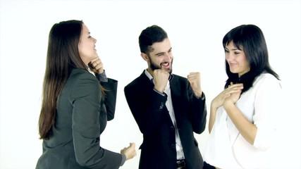Three happy business people dancing in studio