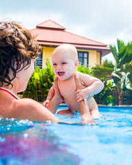 Mother and her daughter in swimming pool