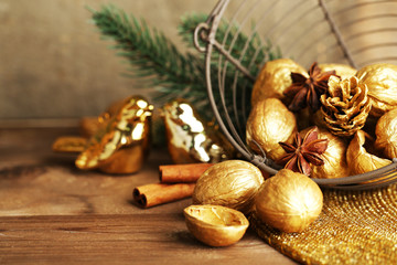 Beautiful Christmas composition with golden walnuts,