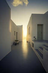 Sunset light between two houses in Santorini Island,Greece