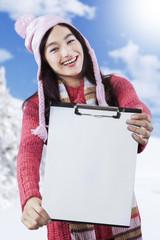 Highschool student displaying empty clipboard