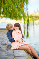 Young dating couple on the Seine embankment
