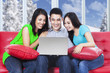 Three asian teenagers with laptop at home