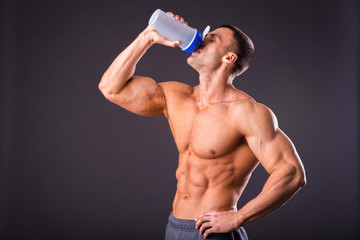 Man is holding a shaker for drinks