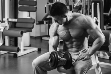 Man at the gym. Man makes exercises