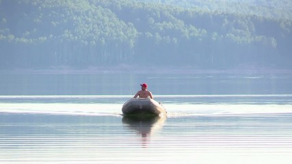 A fisherman in a rubber boat