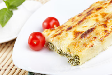 Cannelloni with spinach and ricotta baked in sauce bechamel